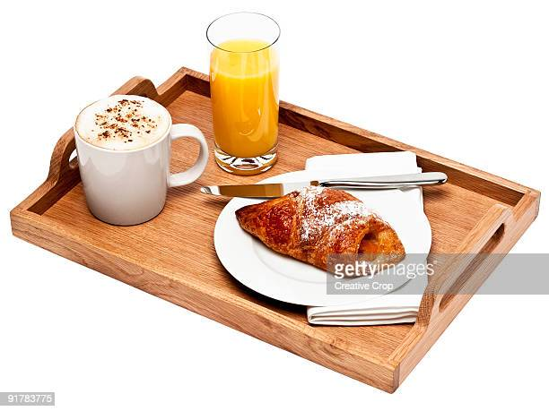 Wooden tray holding continental breakfast