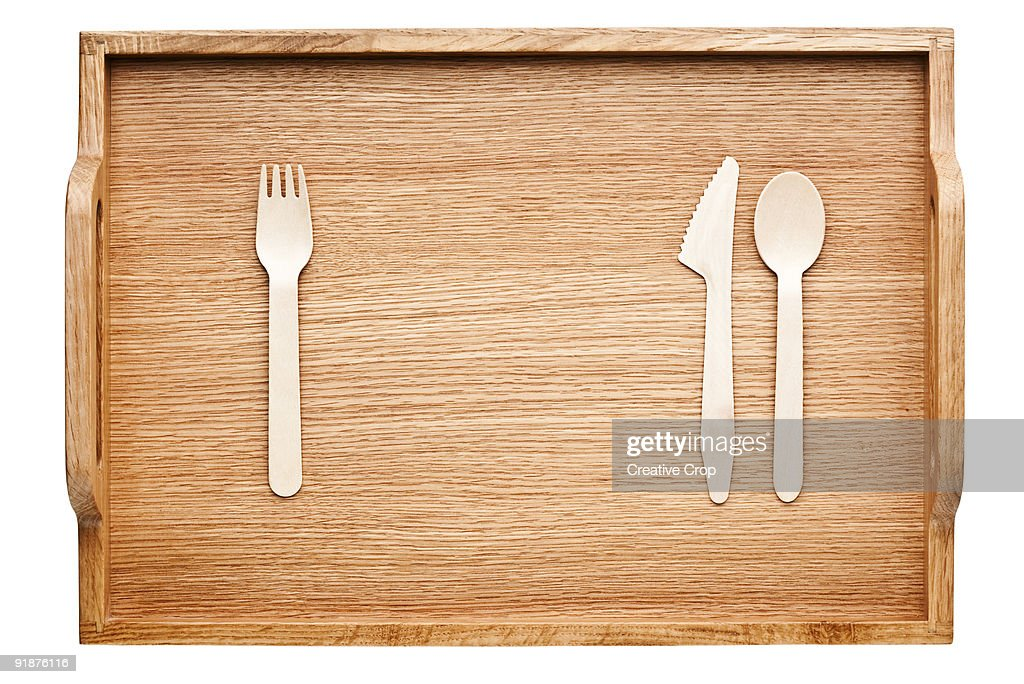 Wooden tray with wooden cutlery