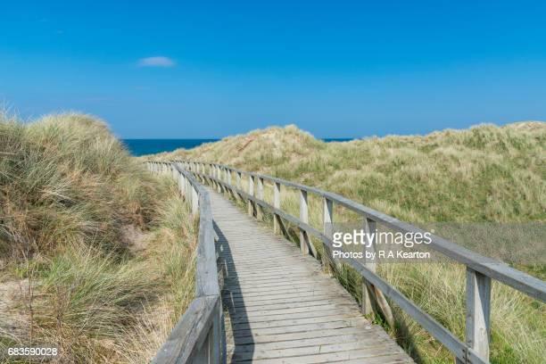 Wooden walkway in dunes at Morfa Dyffryn beach, West Wales