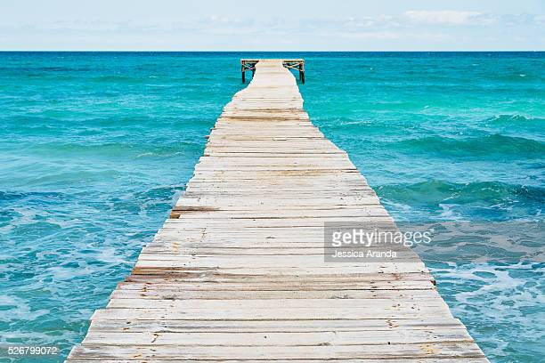 Wooden walkway in the sea at Mallorca