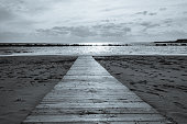 Wooden Walkway on an Italian Beach Out to the Mediterranean Sea