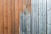 Half painted red wooden fence