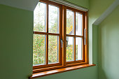 Double glazed wooden window frame in the home in the autumn