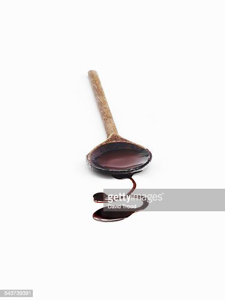 Woodern spoon with melted chocolate