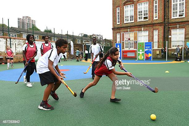 Woodhill Primary School pupils play hockey as they celebrate the opening of its new multiuse sports facility on October 15 2014 in Greenwich England...