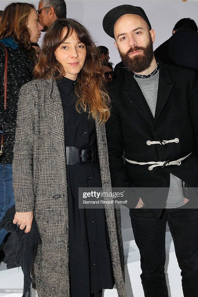 <a gi-track='captionPersonalityLinkClicked' href=/galleries/search?phrase=Woodkid&family=editorial&specificpeople=8986428 ng-click='$event.stopPropagation()'>Woodkid</a> (R) and guest attend the Dior Homme Men Autumn / Winter 2013 show as part of Paris Fashion Week, at Quartier des Celestins on January 19, 2013 in Paris, France.