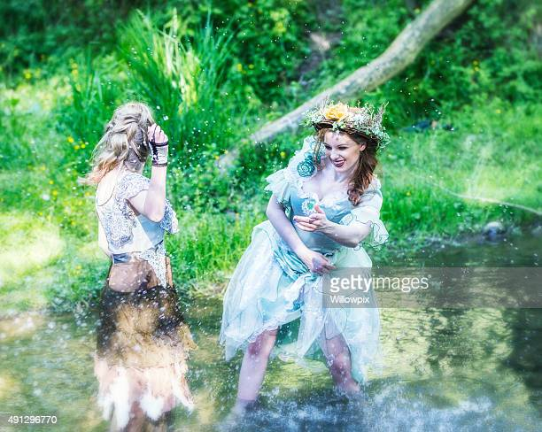 Woodland Fairies Splashing Water In Stream