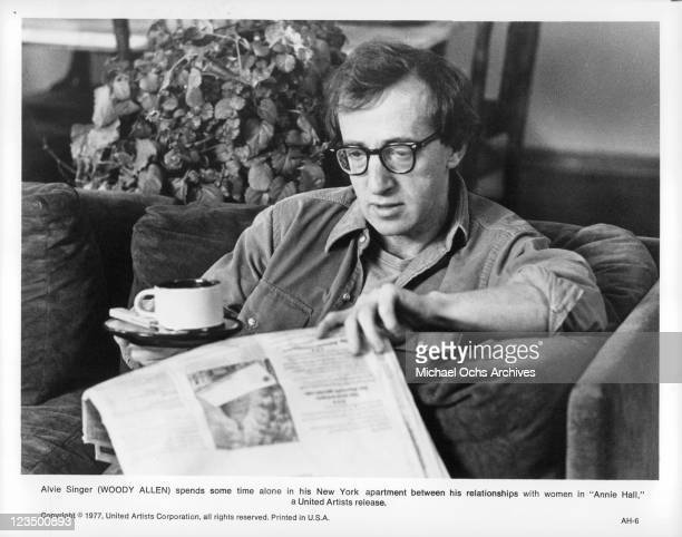 Woody Allen alone reading the newspaper in a scene from the film 'Annie Hall' 1977