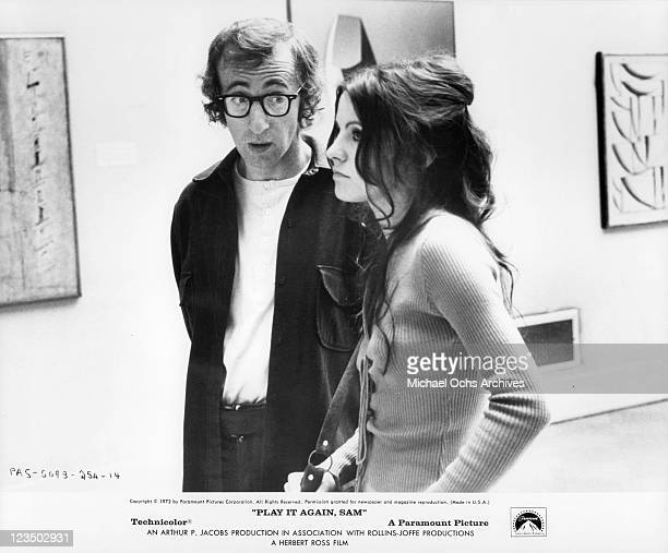 Woody Allen and Diana Davila looking at art together in a scene from the film 'Play It Again Sam' 1972