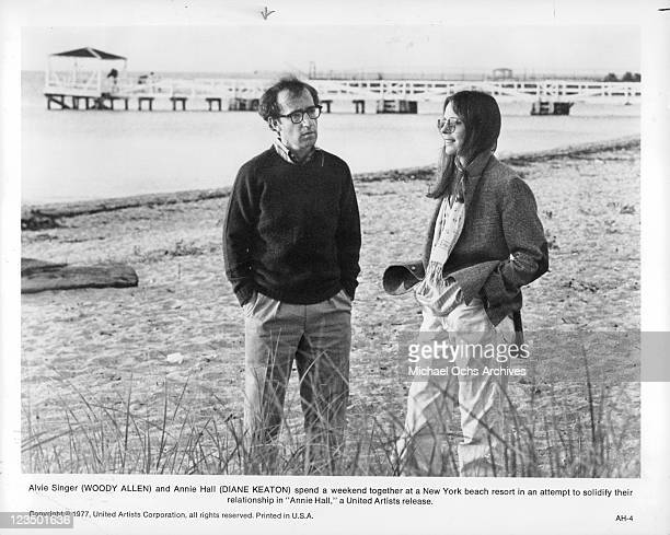 Woody Allen and Diane Keaton are standing in the sand at the beach in a scene from the film 'Annie Hall' 1977