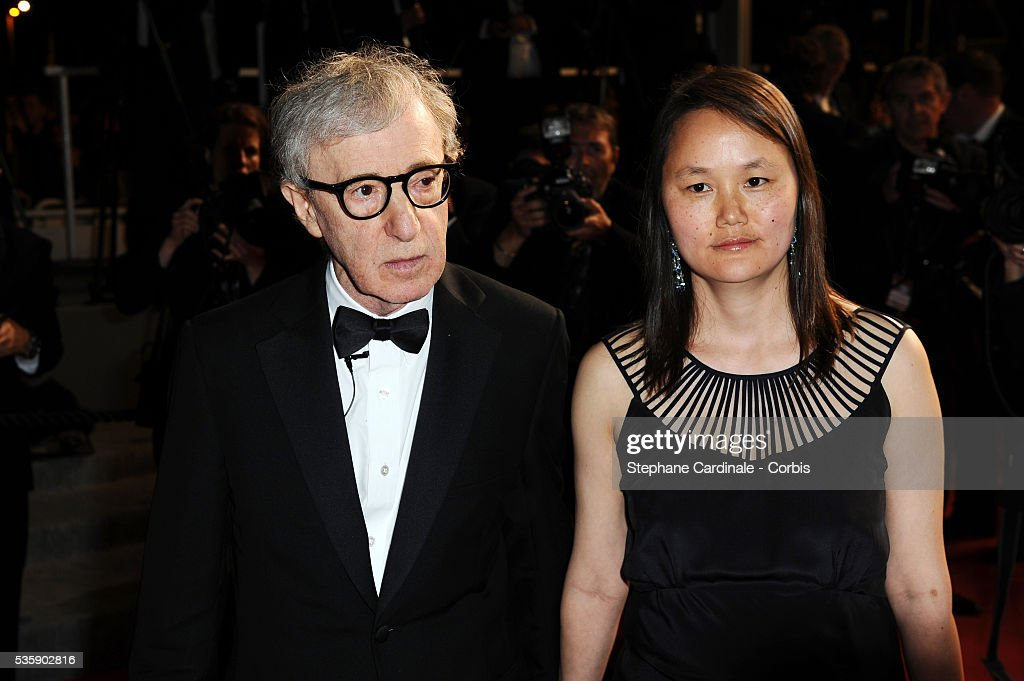 Woody Allen and his wife Soon Yi at the Premiere for 'You will meet a tall dark stranger' during the 63rd Cannes International Film Festival.