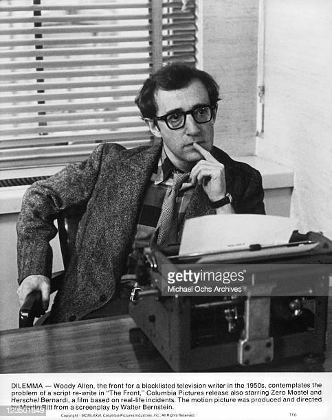 Woody Allen at a typewriter with a finger on his lips in a scene from the film 'The Front' 1976