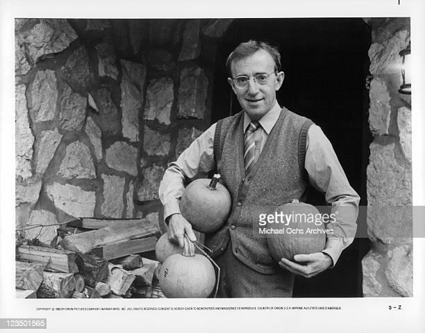 Woody Allen holding pumpkins in a scene from the film 'Zelig' 1983