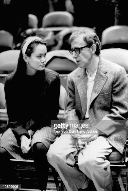 Woody Allen with his adopted daughter SoonYi Previn at New York Knicks game