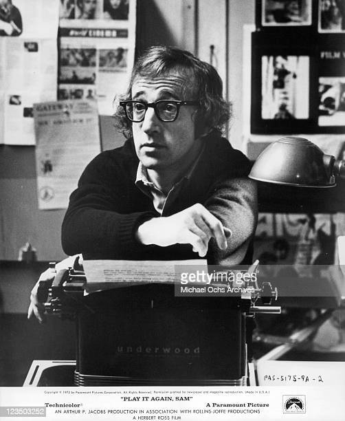 Woody Allen with his arms resting on a typewriter in a scene from the film 'Play It Again Sam' 1972