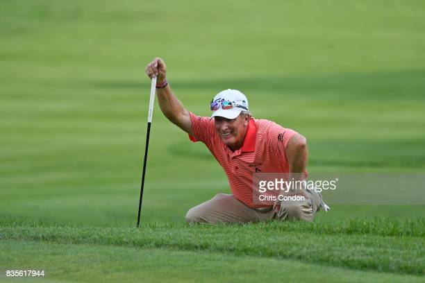 Woody Austin lines up a putt on the 16th green during the second round of the PGA TOUR Champions DICK'S Sporting Goods Open at EnJoie Golf Course on...