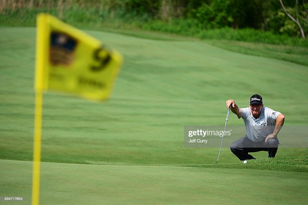 <a gi-track='captionPersonalityLinkClicked' href=/galleries/search?phrase=Woody+Austin&family=editorial&specificpeople=596075 ng-click='$event.stopPropagation()'>Woody Austin</a> lines up a putt on the ninth green during the second round 2016 Senior PGA Championship presented by KitchenAid at the Golf Club at Harbor Shores on May 27, 2016 in Benton Harbor, Michigan.