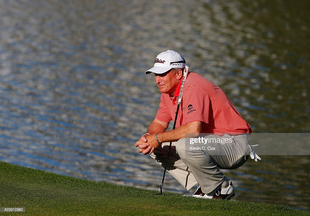 Woody Austin lines up his putt on the 18th green of the first playoff hole during the final round of the Mitsubishi Electric Classic at TPC Sugarloaf...