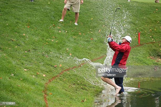 Woody Austin of the US Team plays his second shot from the water at the par 4 14th hole during the round two fourball matches at the Presidents Cup...