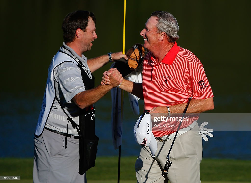 Woody Austin reacts with his caddie after winning the Mitsubishi Electric Classic in a twohole playoff during the final round at TPC Sugarloaf on...