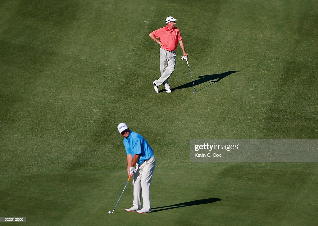 Woody Austin stands in the 18th fairway as Wes Short Jr prepares to hit his third shot on the first playoff hole during the final round of the...