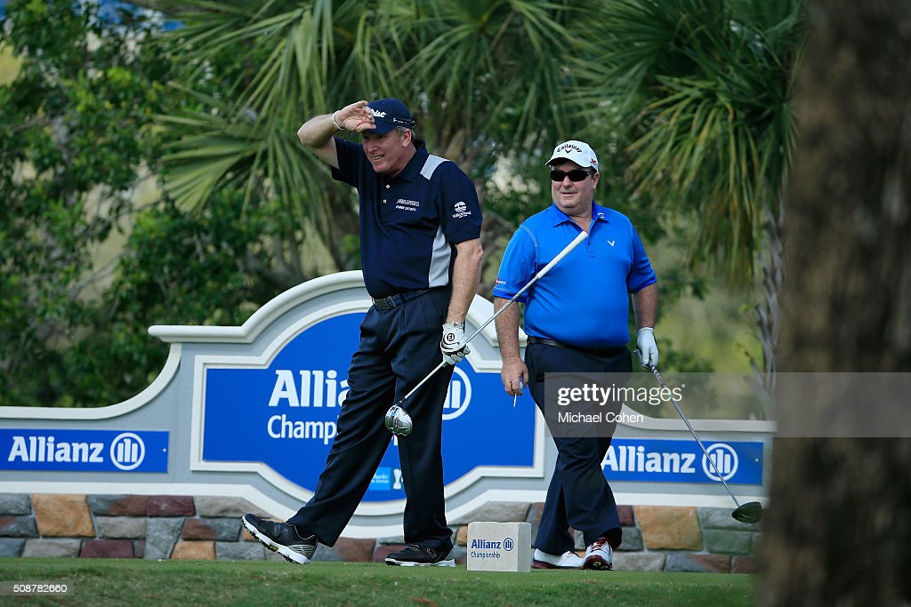 Woody Austin watches his drive on the 11th hole as Craig Parry of Australia looks on during the second round of the Allianz Championship held at The...