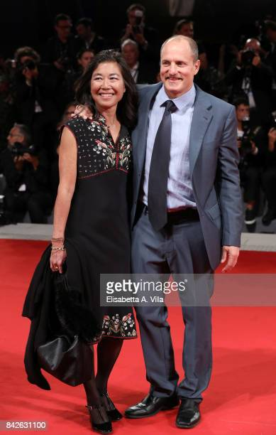 Woody Harrelson and his wife Laura Louie walk the red carpet ahead of the 'Three Billboards Outside Ebbing Missouri' screening during the 74th Venice...