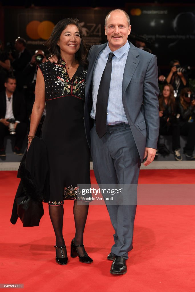 Woody Harrelson and Laura Louie walk the red carpet ahead of the 'Three Billboards Outside Ebbing, Missouri' screening during the 74th Venice Film Festival at Sala Grande on September 4, 2017 in Venice, Italy.