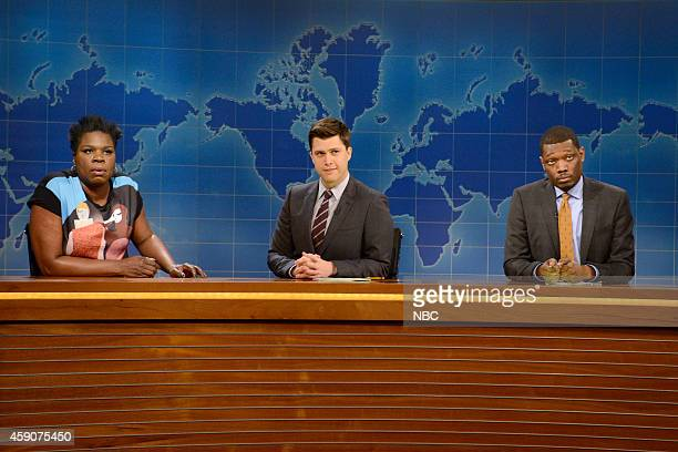 LIVE 'Woody Harrelson' Episode 1668 Pictured Relationship expert Leslie Jones Colin Jost and Michael Che during Weekend Update on November 15 2014