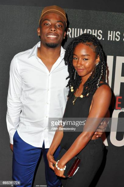 Woody McClain and a guest attend the premiere of Fathom Events' 'Chris Brown Welcome To My Life' at Regal LA Live Stadium 14 on June 6 2017 in Los...