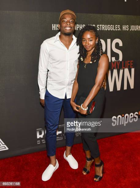 Woody McClain and guest attend the premiere of 'Chris Brown Welcome to My Life' at Regal LA Live Stadium 14 on June 6 2017 in Los Angeles California