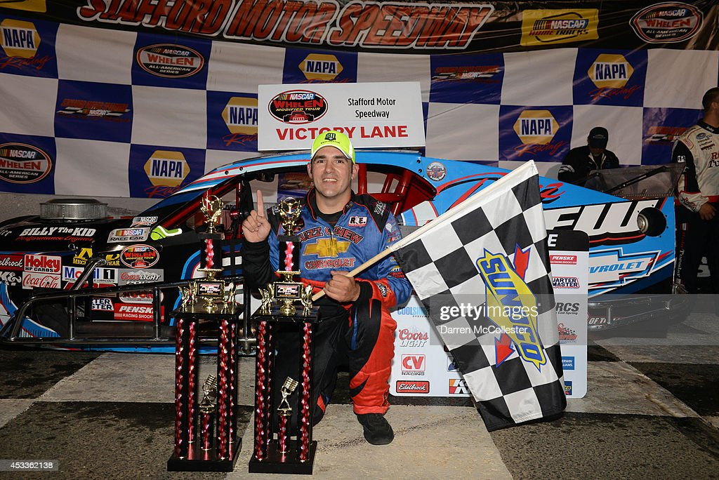 Woody Pitkat driver of the #88 Buzz Chew/Elbow East Chevrolet celebrates after winning the Call Before You Dig 811 150 at Stafford Motor Speedway August 8, 2014 in Stafford, Connecticutt.