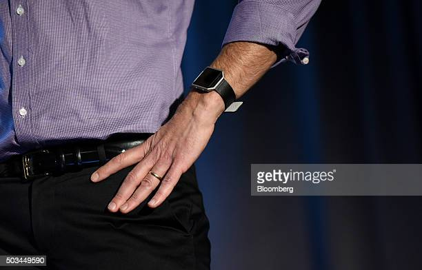 Woody Scal chief revenue officer of Fitbit Inc wears a Fitbit Blaze fitness tracker while speaking during an event at the 2016 Consumer Electronics...
