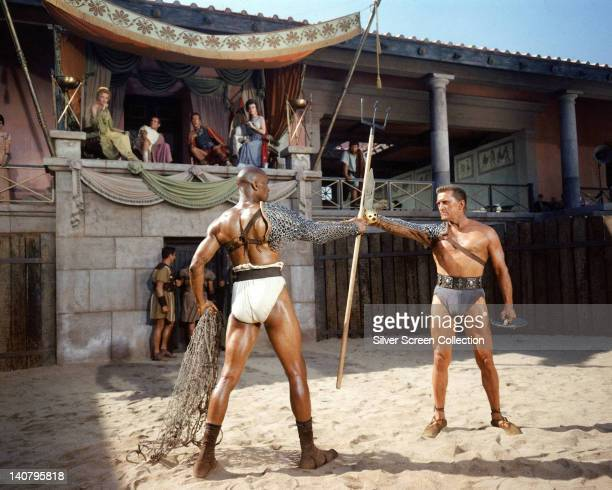 Woody Strode US actor Kirk Douglas US actor and in the background on the balcony Laurence Olivier British actor John Gavin US actor and Nina Foch...