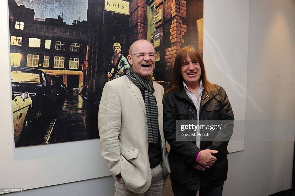 Woody Woodmansey (L) and Trevor Bolder attend the unveiling of a plaque dedicated to David Bowie's famous character Ziggy Stardust on March 27, 201 in London, England. The plaque has been installed on Heddon Street, London, which was the location of the album cover photograph for 'The Rise and Fall of Ziggy Stardust and the Spiders from Mars'.