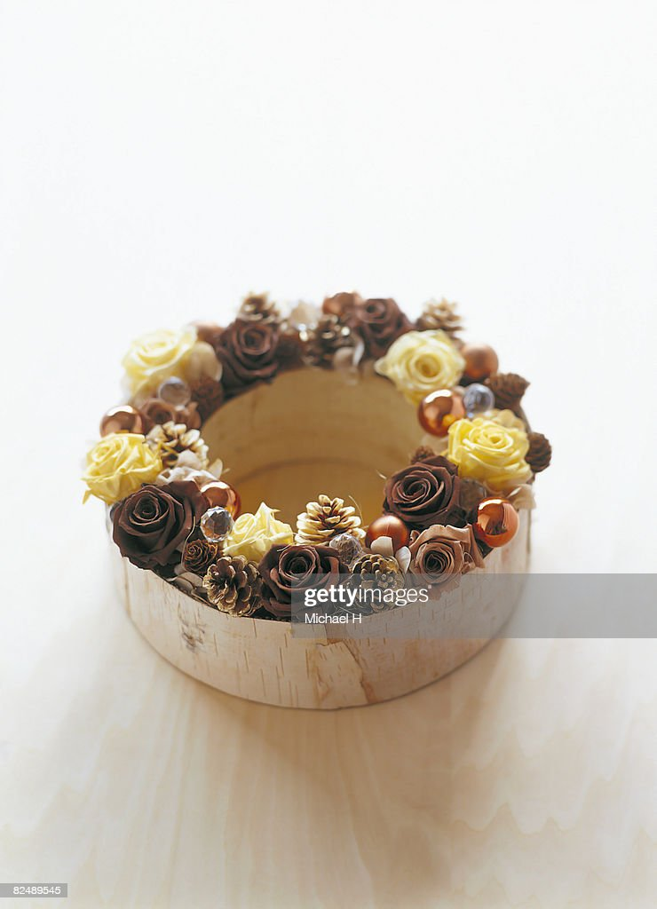 Woody wreath of rose and pine cone  : Stock Photo