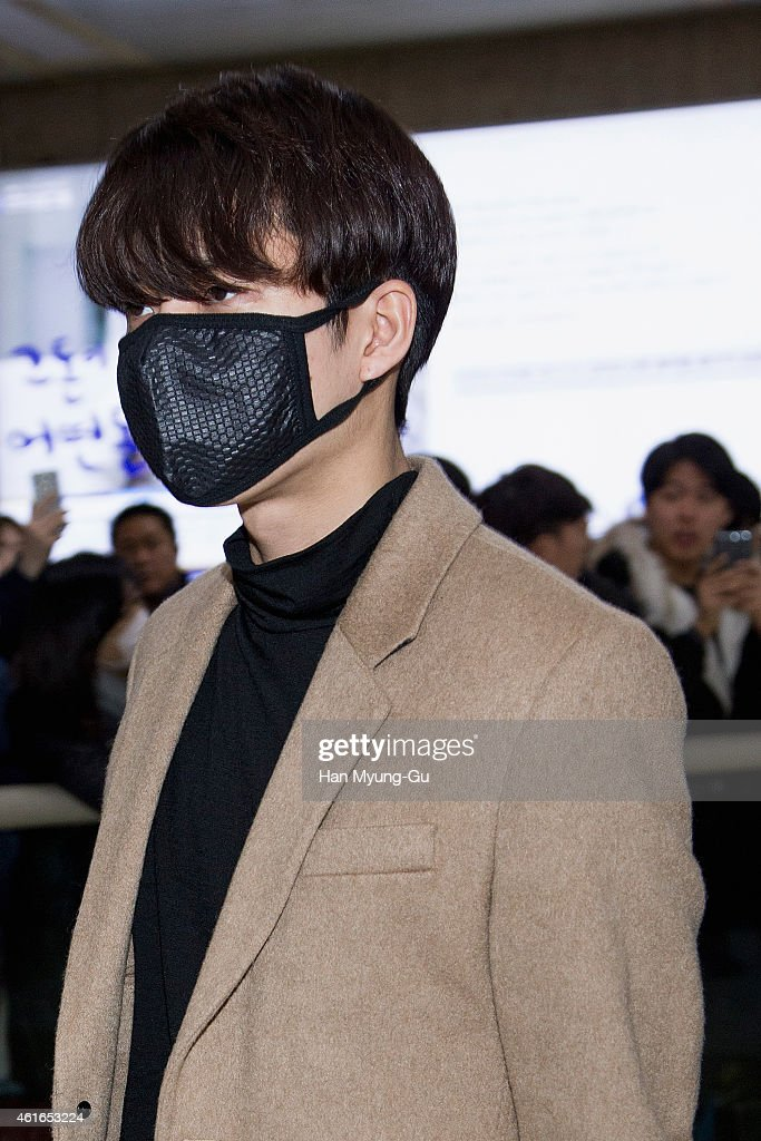 Woohyun of South Korean boy band Infinite is seen upon arrival at Gimpo International Airport on January 16 2015 in Seoul South Korea