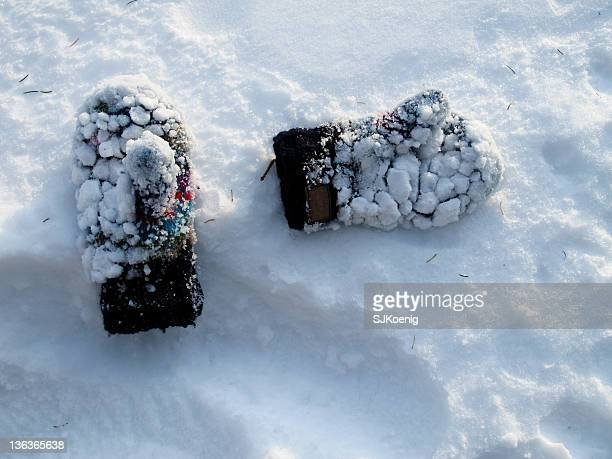 Wool mittens covered in snow
