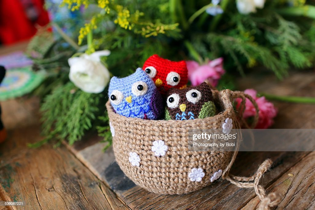 Wool owl crocheted in the basket on the table