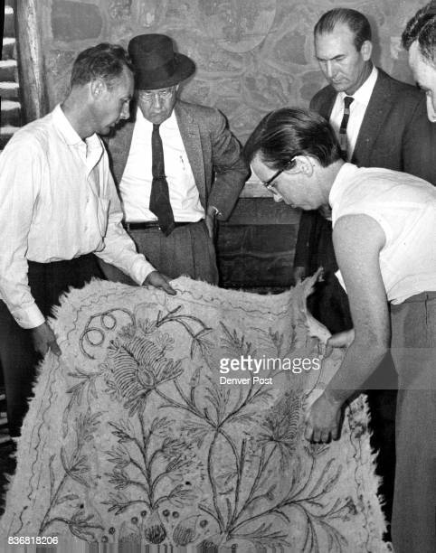 Wooley and Mrs Walker show how body was wrapped at cabin Watching are ass't prosecutor Carl Cline Capt Harold Bray Jefferson County D A Barney O'Kane...