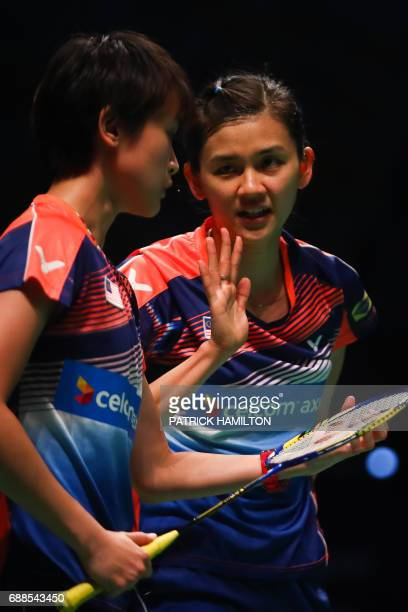Woon Khe Wei and Vivian Hoo of Malaysia confer during their women's doubles Sudirman Cup match against Japan's Misaki Matsutomo and Ayaka Takahashi...
