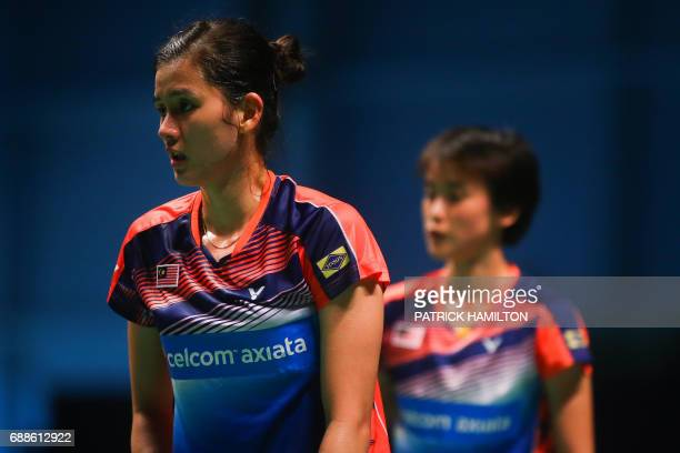 Woon Khe Wei and Vivian Hoo of Malaysia pause between points during their women's doubles Sudirman Cup match against Japan's Misaki Matsutomo and...