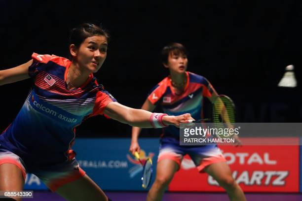 Woon Khe Wei and Vivian Hoo of Malaysia play a return during their women's doubles Sudirman Cup match against Japan's Misaki Matsutomo and Ayaka...