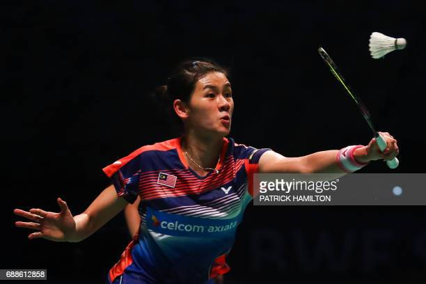 Woon Khe Wei of Malaysia plays a return during her women's doubles Sudirman Cup match with partner Vivian Hoo against Japan's Misaki Matsutomo and...