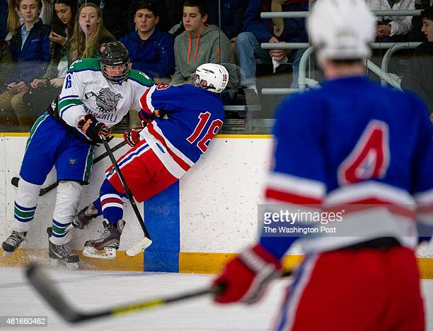Wootten's Harrison Linowes is slammed into the wall by Churchill's Trevor Dixon in the first period as Wootton plays Churchill in high school hockey...