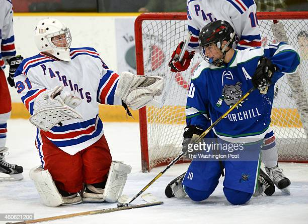Woottton goalie Jake Mitchell left looks for a penalty call against Wiston Churchill's Ross Allen during a game against Winston Churchill at the...