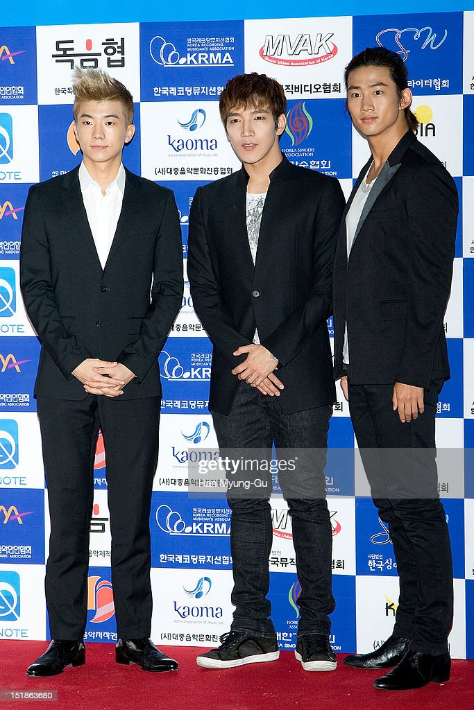 Wooyoung, Junsu and <a gi-track='captionPersonalityLinkClicked' href=/galleries/search?phrase=Taecyeon&family=editorial&specificpeople=7419778 ng-click='$event.stopPropagation()'>Taecyeon</a> of South Korean boy band 2PM arrives the launch event of 'Popular Music Promotion Committee' on September 12, 2012 in Seoul, South Korea.