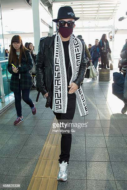 Wooyoung of South Korean boy band 2PM is seen on departure at Incheon International Airport on November 12 2014 in Incheon South Korea