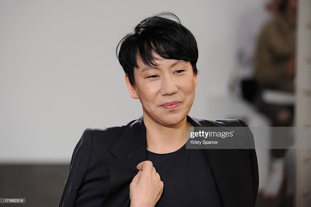 <a gi-track='captionPersonalityLinkClicked' href=/galleries/search?phrase=Wooyoungmi&family=editorial&specificpeople=4823501 ng-click='$event.stopPropagation()'>Wooyoungmi</a> acknowledges the audience during the during the <a gi-track='captionPersonalityLinkClicked' href=/galleries/search?phrase=Wooyoungmi&family=editorial&specificpeople=4823501 ng-click='$event.stopPropagation()'>Wooyoungmi</a> Menswear Spring/Summer 2014 show as part of Paris Fashion Week on June 27, 2013 in Paris, France.