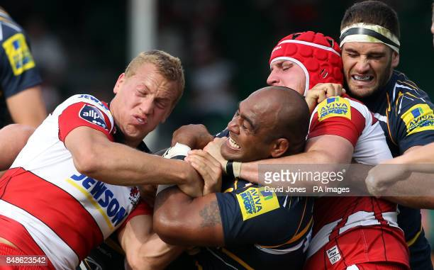 Worcester Warriors' Aleki Lutui is held by Gloucester's Billy Twelvetrees and Ben Morgan during the Aviva Premier League match at Sixways Worcester